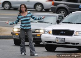 Prostitute Exposes Herself to Passing Motorists