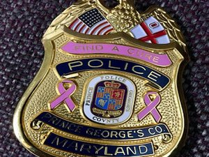 Officers Proudly Wearing Badges Marking Breast Cancer Awareness Month