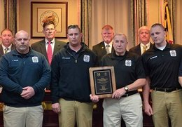 Injured firefighters attend meeting, accept plaque
