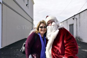 Carolers visit small business